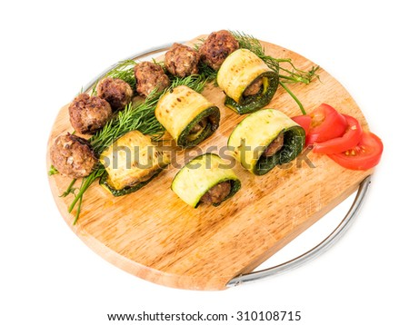 Meatball appetizers with marrow, on a wood dish isolated on white studio background - stock photo