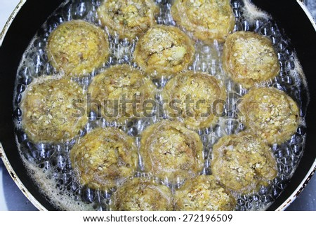 Meatball are fried in a pan with oil. - stock photo
