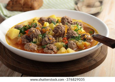Meatball soup on a rustic table