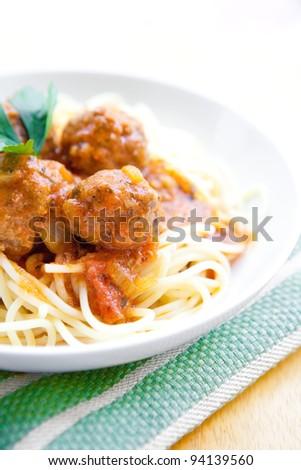 Meatball spaghetti served outdoor - stock photo