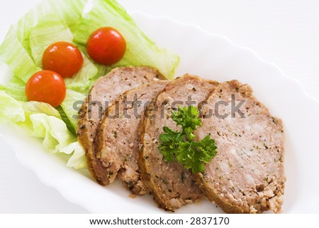 Meatball with small salad on white plate