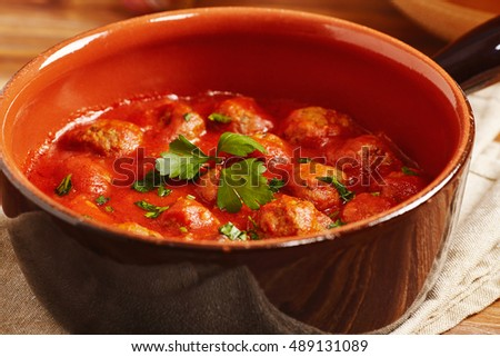 Meatball with tomato sauce in a pot, country style