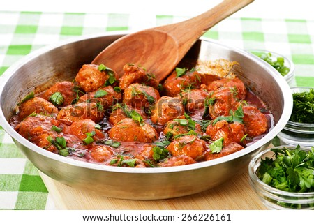 Meatballs cooked in tomato sauce - stock photo