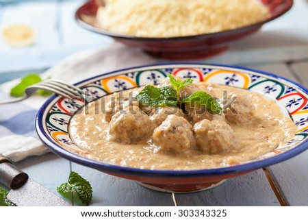 meatballs in almond and lemon sauce on decorated bowl - stock photo