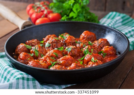Meatballs in sweet and sour tomato sauce - stock photo