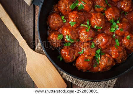 Meatballs in sweet and sour tomato sauce. Top view - stock photo