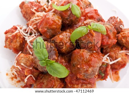 meatballs in tomato sauce with basil leaves