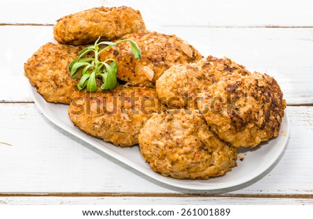 Meatballs on a plate isolated on wooden planks background - stock photo