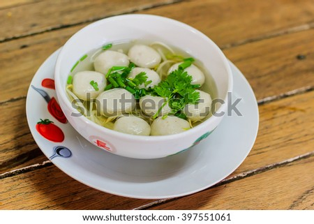 Meatballs pork cooked in a tasty soup garnished with coriander - stock photo
