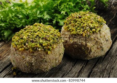 meatballs seasoned with pistachios - stock photo