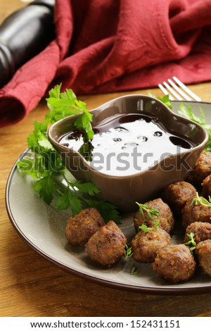 meatballs - traditional meat dish with sauce and herbs - stock photo