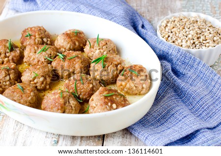 Meatballs with barley, selective focus - stock photo