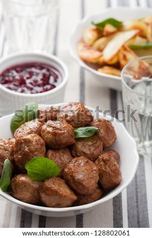 meatballs with potatoes and lingon jam - stock photo
