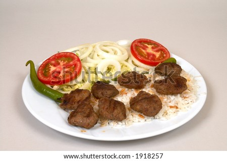 Meatballs with rice and salads - stock photo