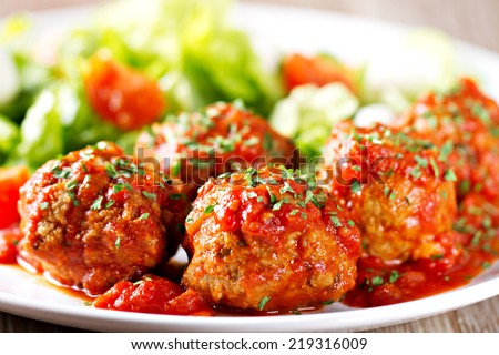 Meatballs with salad - stock photo