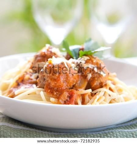 Meatballs with spaghetti in tomato sauce - stock photo