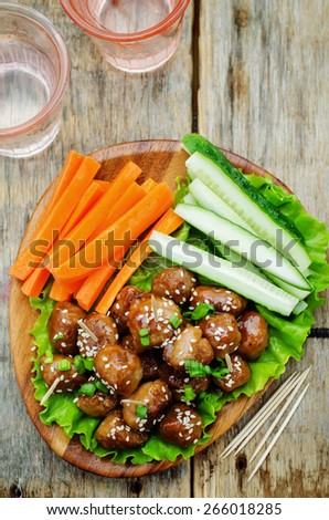 meatballs with Teriyaki sauce and sesame seeds on a dark wood background. tinting. selective focus - stock photo