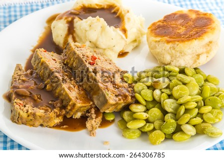 Meatloaf dinner with mashed potatoes and gravy and baby lima beans ...