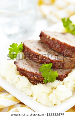 Meatloaf on mashed potato - stock photo