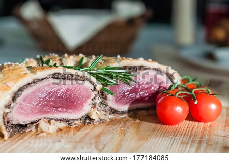Meatloaf sectional with tomatoes and sesame seeds - stock photo