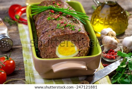Meatloaf with boiled eggs   - stock photo