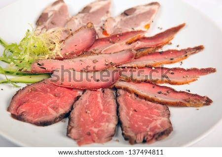 meaty food : roast meat steak sliced over green hot chili peppers - stock photo