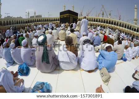 MECCA - CIRCA APRIL 2012 :Fish eye lens view of Muslim pilgrims ready for prayers at Masjidil Haram Mosque CIRCA APRIL 2012 in Mecca. Muslims all around the world face the Kaaba during prayer time.  - stock photo