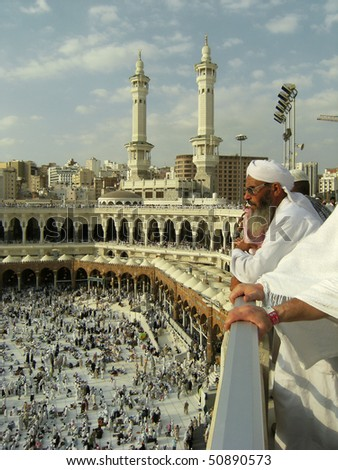 MECCA - DEC 8 : A Muslim watch pilgrims get ready for prayer from third floor of Haram Mosque Dec 8, 2007 in Mecca. Millions of muslims around the world come here for hajj during this time. - stock photo