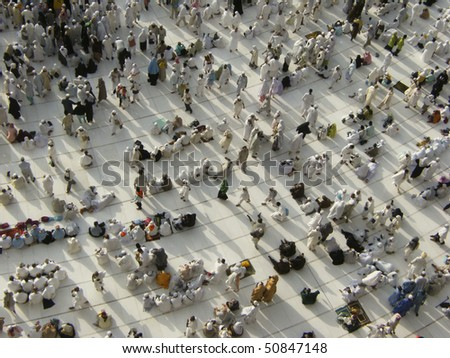 MECCA - DEC 6 : View from third floor of Haram Mosque where  Muslim pilgrims get ready for prayer Dec 6, 2007 in Mecca. Millions of muslims around the world come for hajj during this time. - stock photo
