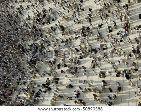 MECCA - DEC 8 : View from third floor of Haram Mosque where Muslim pilgrims get ready for prayer Dec 8, 2007 in Mecca. Millions of muslims around the world come for hajj during this time. - stock photo