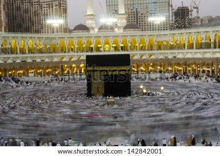 MECCA - FEB  20 : A 5-second exposures of pilgrims circumabulate (tawaf) Kaaba on Feb 20, 2012 in Makkah, Saudi Arabia. Pilgrims circumambulate the Kaaba seven times in counterclockwise direction. - stock photo
