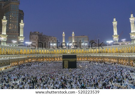 MECCA-FEB 20, 2012 : Muslim pilgrims circumambulate the Kaaba at sunset at Masjidil Haram in Makkah, Saudi Arabia. Muslims all around the world face the Kaaba during prayer time.
