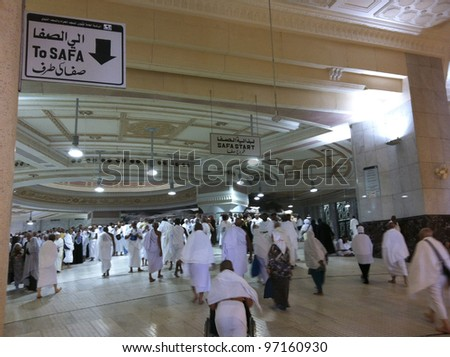 MECCA-FEB.25: Muslim pilgrims reach Safa mount from Marwah mount on February 25, 2012 in Mecca. Muslim pilgrims perform 7 rounds of brisk walking from Safa mount to Marwah mount. - stock photo