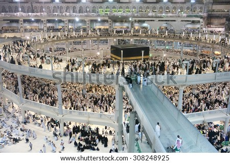 MECCA - JULY 06 : Crowd of pilgrims circumambulate around Kaaba on July 06, 2015 in Mecca,Saudi Arabia. Pilgrims circumambulate seven times to show their submission to the religion.  - stock photo