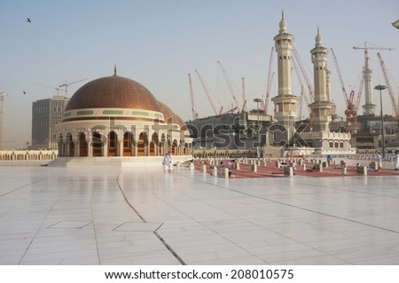 MECCA, S.ARABIA-MAY 31: One of the domes of the mosque at the Masjidil Haram. May 31 2013 atmosphere on the Grand Mosque building, look for pilgrims walking and the construction is being done. - stock photo