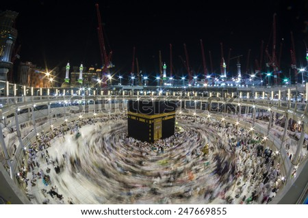 MECCA, SAUDI ARABIA-CIRCA DEC 2014: WIde angle view of Muslim pilgrims circumambulate the Kaaba counter-clockwise at Masjidil Haram in Makkah, Saudi Arabia. - stock photo