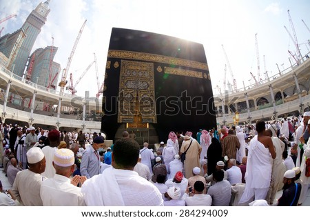 MECCA, SAUDI ARABIA-CIRCA MAY 2015: Fisheye view of Muslims gettiing ready to pray around the Kaaba in Masjidil Haram in Makkah, Saudi Arabia. The mosque is under construction to expand space for hajj - stock photo