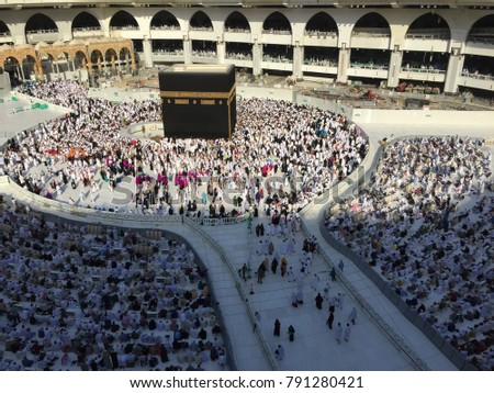 MECCA,SAUDI ARABIA-DECEMBER 21 2017:people revolve around kaabah at the center of Masjidil Haram during late evening