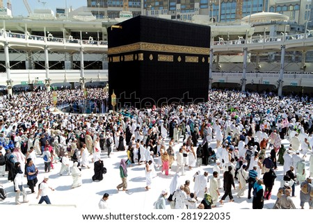 MECCA SAUDI ARABIA  FEBRUARY 4: Muslim pilgrims from all around the World revolving around the Kaaba on February 4 2015 in Mecca Saudi Arabia. Muslim people praying together at holy place.