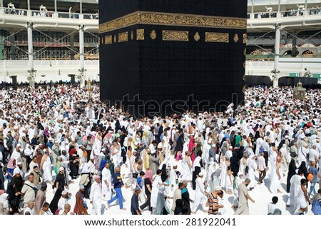 MECCA SAUDI ARABIA  FEBRUARY 4: Muslim pilgrims from all around the World revolving around the Kaaba on February 4 2015 in Mecca Saudi Arabia. Muslim people praying together at holy place. - stock photo