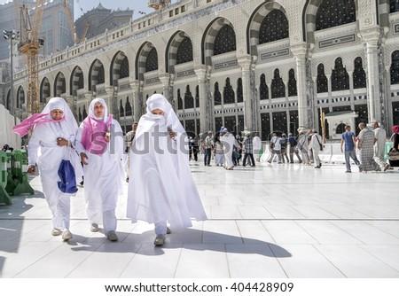MECCA, SAUDI ARABIA - FEBRUARY 4: Muslim women walking on the road in the newly built Kaaba on February 4, 2015 in Mecca, Saudi Arabia.  - stock photo