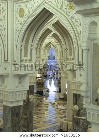 MECCA, SAUDI ARABIA - JAN 5 : Interior of Masjidil Haram (Haram Mosque) on Jan 5, 2008 in Mecca, Saudi Arabia. Muslim pilgrims from all around the world perform hajj during this time. - stock photo