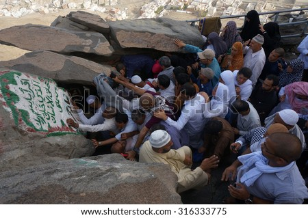 MECCA, SAUDI ARABIA - JUNE 2 : Muslims awaiting their turn to perform prayers at the cave of Hira on June 2, 2013. It was here that the first occurrence of revelation to Prophet Muhammad. - stock photo