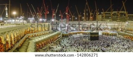 MECCA, SAUDI ARABIA - JUNE 3 : Ongoing work of Mataf expansion at Haram Mosque June 3, 2013 in Makkah. The expansion scheduled to complete in 2 years to accommodate more pilgrims during haj time. - stock photo