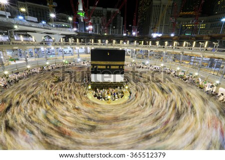 MECCA-SEPTEMBER 05:Crowd of pilgrims circumambulate around Kaaba on SEPTEMBER 05,2015 in Mecca,Saudi Arabia. Pilgrims circumambulate seven times to show their submission to the religion. - stock photo