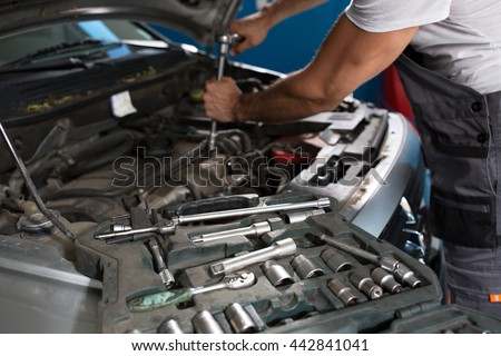 Mechanic at work in auto service