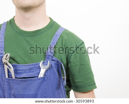 Mechanic at work with a pincer and a wrench - stock photo