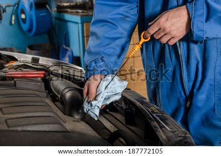 Mechanic changing oil - stock photo