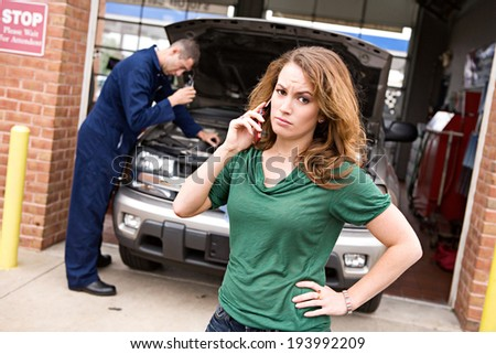 Mechanic: Customer On Phone And Upset About Car Repair - stock photo