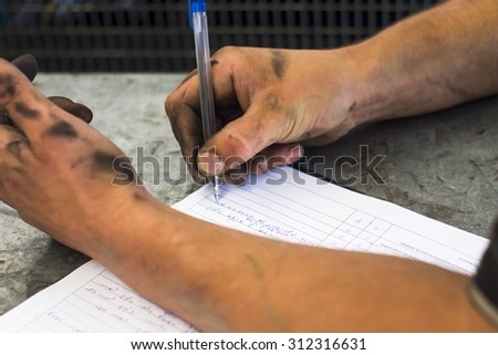 mechanic fills with dirty hands leaf diagnostic - stock photo